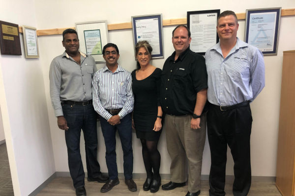 Denise Conradie with the Lonza management team (from left to right) Martin Reddy (Environmental Health & Safety Manager); Kesun Govender (Operations Manager); JJ du Plessis (Senior Business Manager) and Ross Skorpen (Financial Manager).
